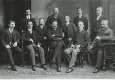 Henry Vivian (seated centre), Harry C. Perry (left of and slightly behind Vivian), Hubert Brampton (front row, right of Vivian), William Hutchings (seated 2nd from left), Fred Watts (seated far right), Fred Litchfield (standing far right).
